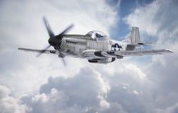 World War II era fighter flies among clouds and blue sky. A P-51 Mustang, World War II era fighter, flies among clouds and blue sky. (This is a detailed model stock images