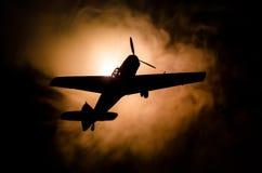 World war ii fighter plane at sunset or dark orange fire explosion sky. War scene. German figher at sky. Selective focus royalty free stock images