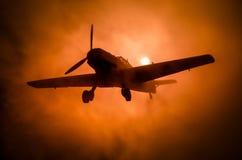 World war ii fighter plane at sunset or dark orange fire explosion sky. War scene. German figher at sky. Selective focus stock image
