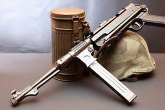 World War II Germany Equipment. World War II Germany soldier equipment. Machinegun MP-38 near helmet and respirator case royalty free stock photos