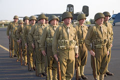 World War II Infantry troops. Standing at attention with sunset light on them with B-25 Bomber in the background at Mid-Atlantic Air Museum World War II Weekend Stock Photo
