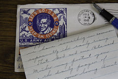 World War II Letter, envelope and fountain pen on oak desk. Royalty Free Stock Images