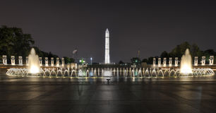 World War II Memorial at night. With the Washington Monument in the background Royalty Free Stock Images
