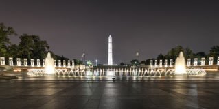 World War II Memorial at night. With the Washington Monument in the background Stock Photo