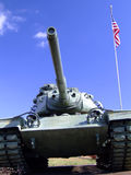 World War II Tank and Flag. World war two tank and flag against blue sky Royalty Free Stock Photo