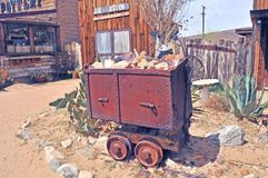 Pioneer Town: Ore Cart On Rail Track. After World War II, there was a mining boom in the Mojave desert where prospectors searched for strategic metals such as royalty free stock photography