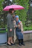 World War II veteran accompanied by relative on Victory Day celebration in Volgograd Stock Photos