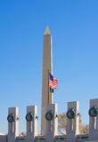 World War II And Washington Monuments. Portion of the World War II Monument with the American flag and the Washington Monument in the background, Washington D.C Stock Photos
