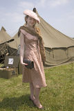 World War II young woman poses in front of army tents Royalty Free Stock Photography