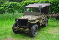 World War 2 Jeep  parked in the woods. Royalty Free Stock Photo