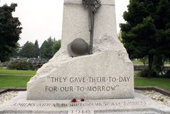 World War Memorial. A world war memorial made of stone, stands proudly in the park of Smiths Falls, Ontario Stock Image