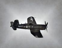 World War 2 Navy airplane. World War 2 era Navy airplane in flight stained old photo Royalty Free Stock Photos