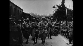 World War 1 – French colonial troops marching into a railroad station. World War One. Black and White. French colonial soldiers walking in a railroad station stock footage
