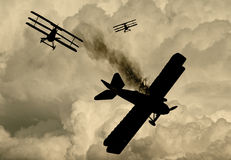 World War One Era aircraft. Silhouette of World War One Bi-planes and Tri-planes engaged in a dogfight. (Artist's impression Stock Photography