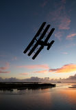World War One Era aircraft. Silhouette image of World War One Tri-plane flying during a nice sunset or sunrise. (Artists impression Stock Photos