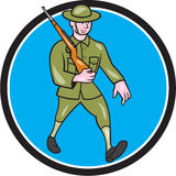 World War One Soldier British Marching Circle Cartoon. Illustration of a World War one British soldier serviceman marching with assault rifle viewed from side Royalty Free Stock Photo