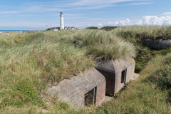 World war two bunker in front of Hirtshals Fyr Lighthouse, Denmark Royalty Free Stock Images