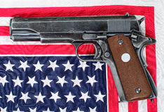 World war two gun placed on an American flag Stock Photos