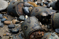 World War two ordnance on beach. World War two ordnance burried to dispose at the end of the conflict reappearing on UK east coast beach Royalty Free Stock Photography