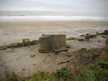 World War Two Pillbox. World War Two concrete pillbox on the east coast of Yorkshire, England, United Kingdom. Loopholes sealed with concrete. Surrounded by a stock image