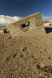 World War Two Pillbox sinking into pebbled beach, Chesil Bank. Type 26 WWII pillbox at the western end of the Chesil Beach, Abbotsbury, England, United Kingdom Stock Photography