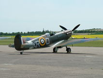 Spitfire aircraft. Side view of a World War Two Spitfire aircraft on a runway Stock Photos