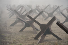 World war two tank traps in fog royalty free stock photo