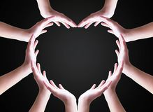 International Human Solidarity Day concept: Collaborative human hands grouped in heart shape stock photos