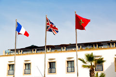 world waving flag in the blue sky  colour  morocco Stock Images