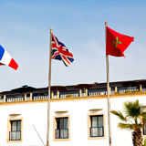 world waving flag in the blue sky  colour and morocco Royalty Free Stock Photos
