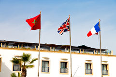 World waving flag in the blue sky  colour and morocco Royalty Free Stock Images