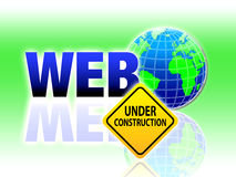 World Web Under Construction Sign. An image for the concept of world wide web site under construction and being redesigned showing a warning sign by an Royalty Free Stock Photography