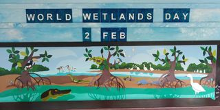 World Wetlands Day painting. World Wetlands Day 2 February signboard featuring a mangrove swamp and its inhabitants royalty free stock photography