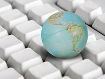 WORLD WIDE. Concept of the world wide web globe on a computer keyboard Stock Photos