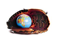 World wide Base ball. Base ball glove in a studio setting over white royalty free stock image