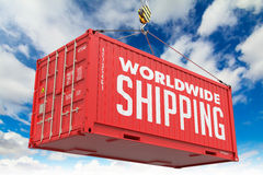 World Wide Shipping - Red Hanging Cargo Container. Stock Photography