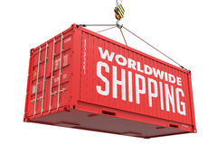 World Wide Shipping - Red Hanging Cargo Container. Stock Images