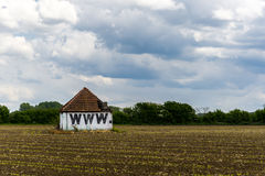 World wide web. Barn, in the middle of a field Stock Photo