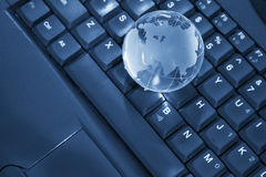 World wide web concept. Globe on a laptop keyboard, internet concept Stock Image