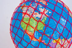 World wide web: United States of America. A macro image of the globe covered by a red mesh representing the inter-connections of the world wide web and internet Royalty Free Stock Photography