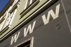 World wide web (www) sign. Web address sign above business in city street Stock Photos
