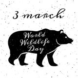 World Wildlife Day. 3 March. Grunge background with black silhouette of bear and lettering Royalty Free Stock Photo