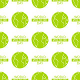 World Wildlife Day seamless pattern. World Wildlife Day tileable background. Vector design element, seamless pattern with symbol of planet Earth. Text and green Royalty Free Stock Photography