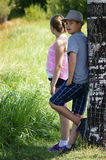 World of Wonder. Two teenagers stand under a tree at the park on summer break Stock Photos