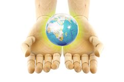 A world on wooden hand Royalty Free Stock Photo