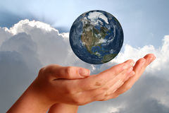 The world in young womans hands Royalty Free Stock Photo