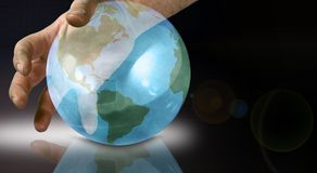 The world at your fingers. Hand on the world royalty free illustration