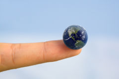 World at your Fingertip. Earth on a human finger Stock Photography