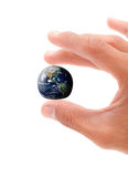 The World At Your Fingertips. With Word In Mans Hand Royalty Free Stock Images