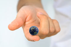 World at your Fingertips. Hand holding earth on fingertip Royalty Free Stock Image